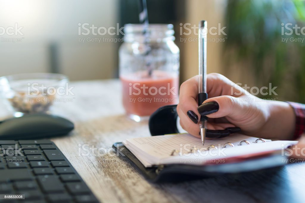 Closeup side view shot of a young businesswoman sitting at her desk...
