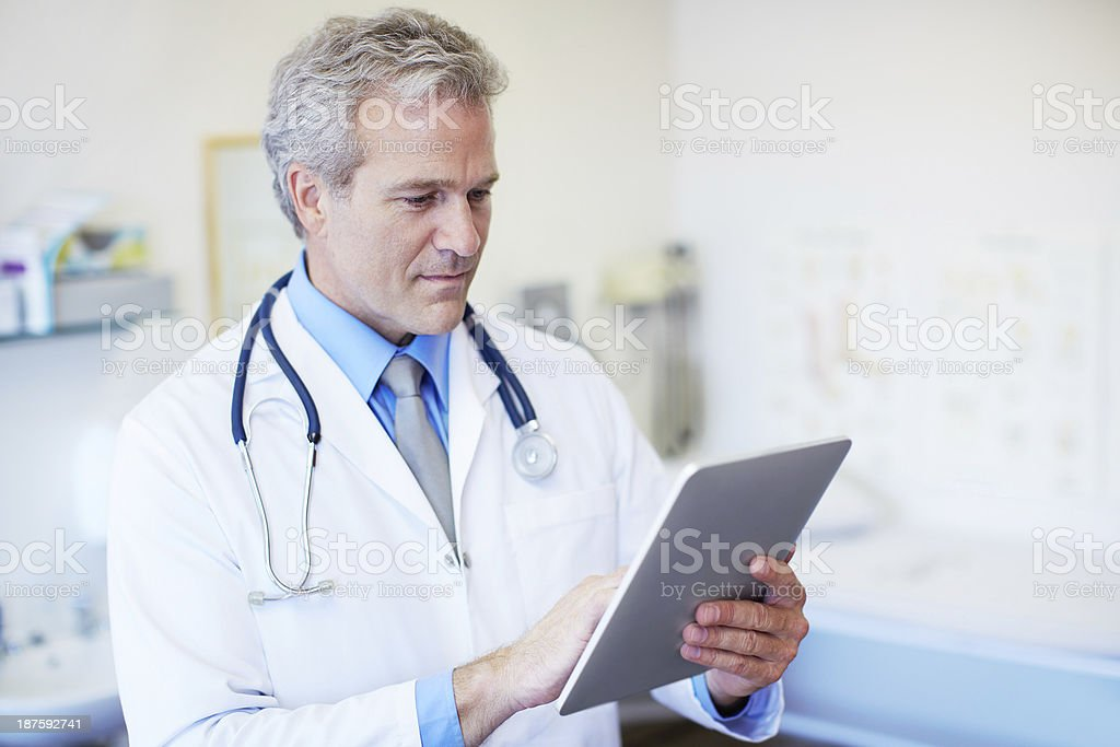 Using his tablet for an accurate diagnosis royalty-free stock photo