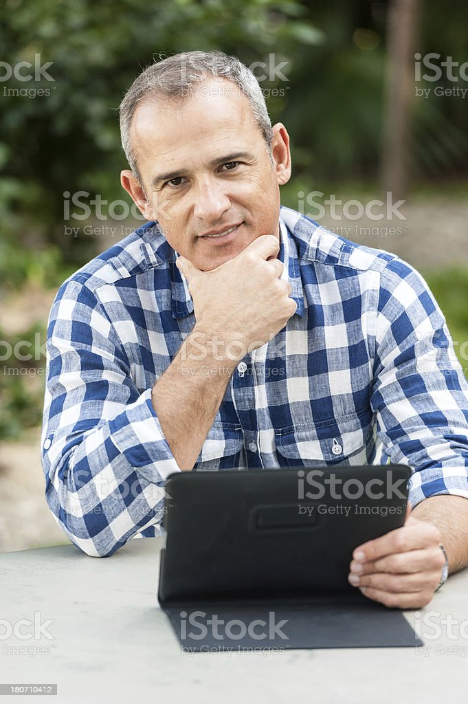 Using his Tablet PC royalty-free stock photo
