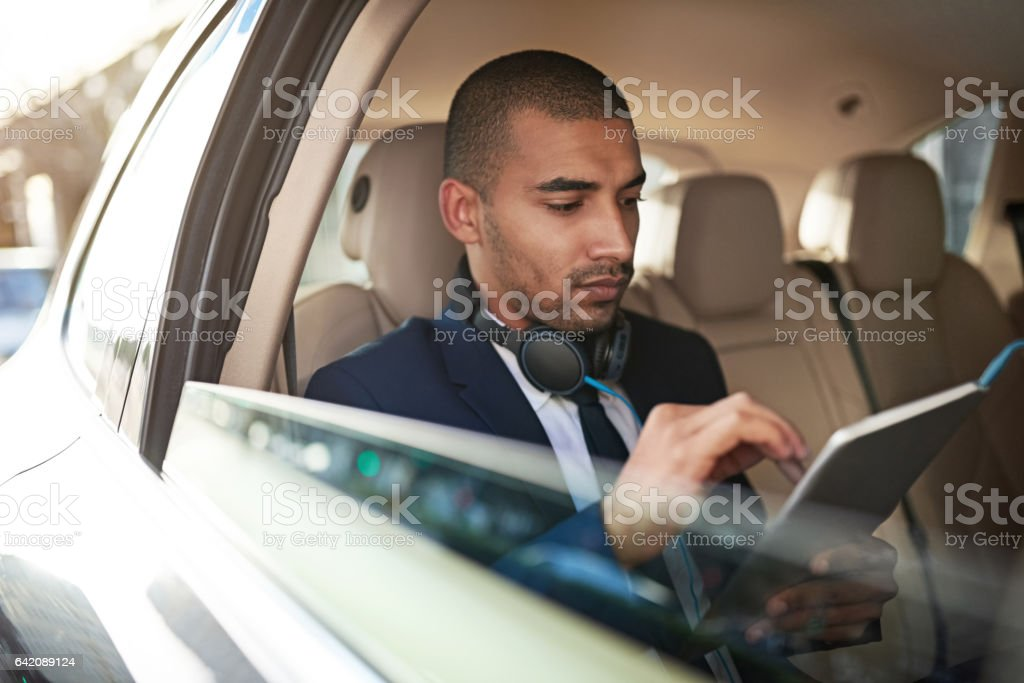 Using his tablet to get to his appointment on time stock photo