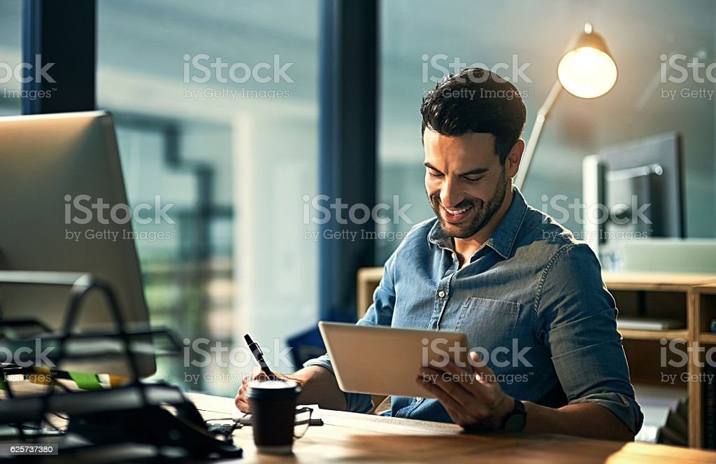 Using his time wisely with smart technology stock photo