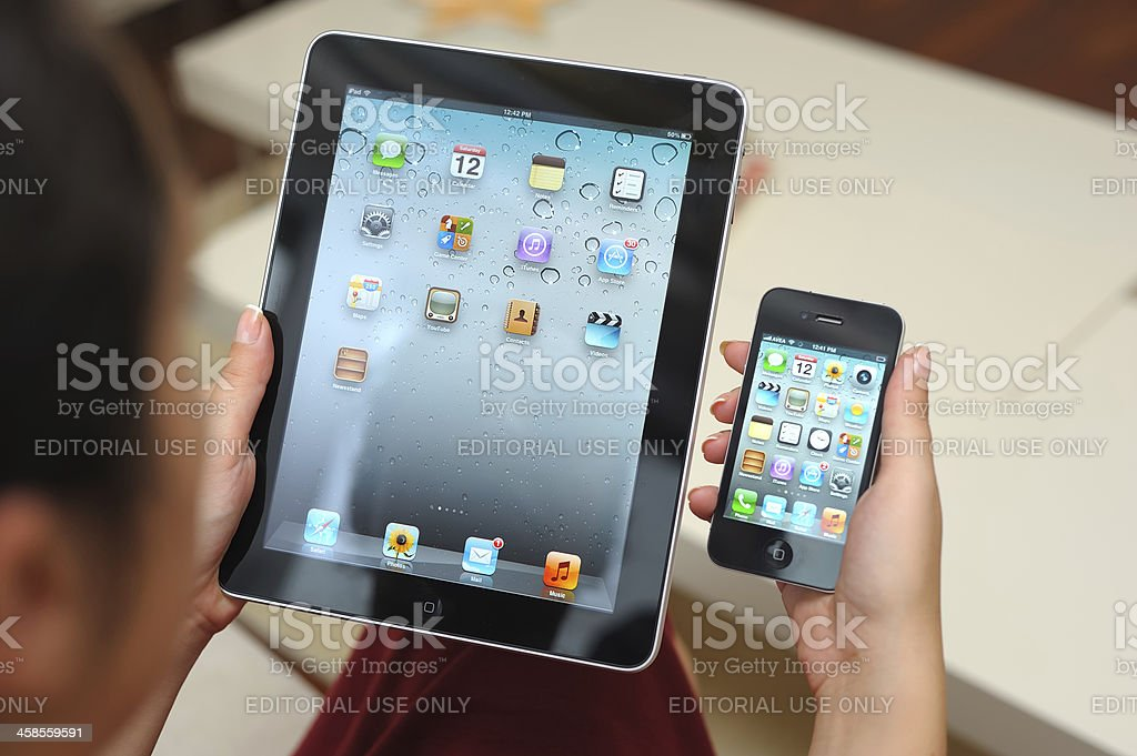 Using iPad and iPhone 4 royalty-free stock photo