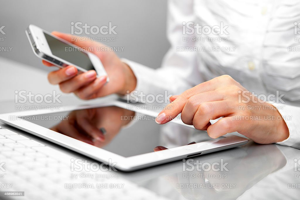 Using iPad and iPhone royalty-free stock photo