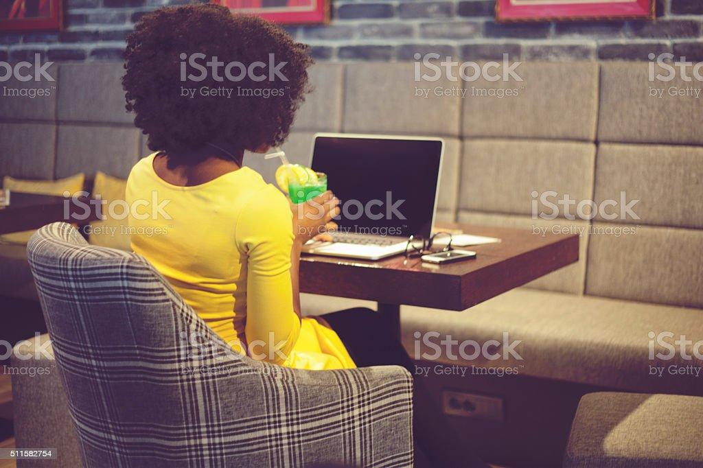 Using lap top stock photo