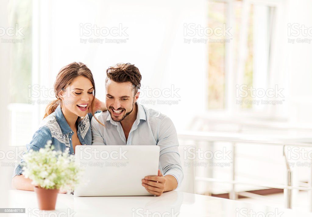 Using laptop at home. stock photo