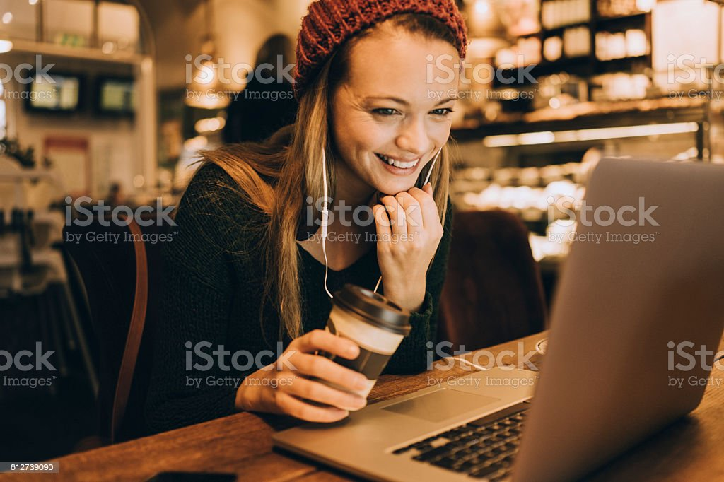 Using laptop in cafe stock photo