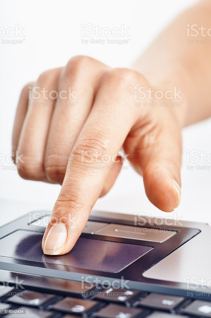 Using laptop touchpad stock photo
