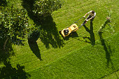 istock Using lawn mower 96926811