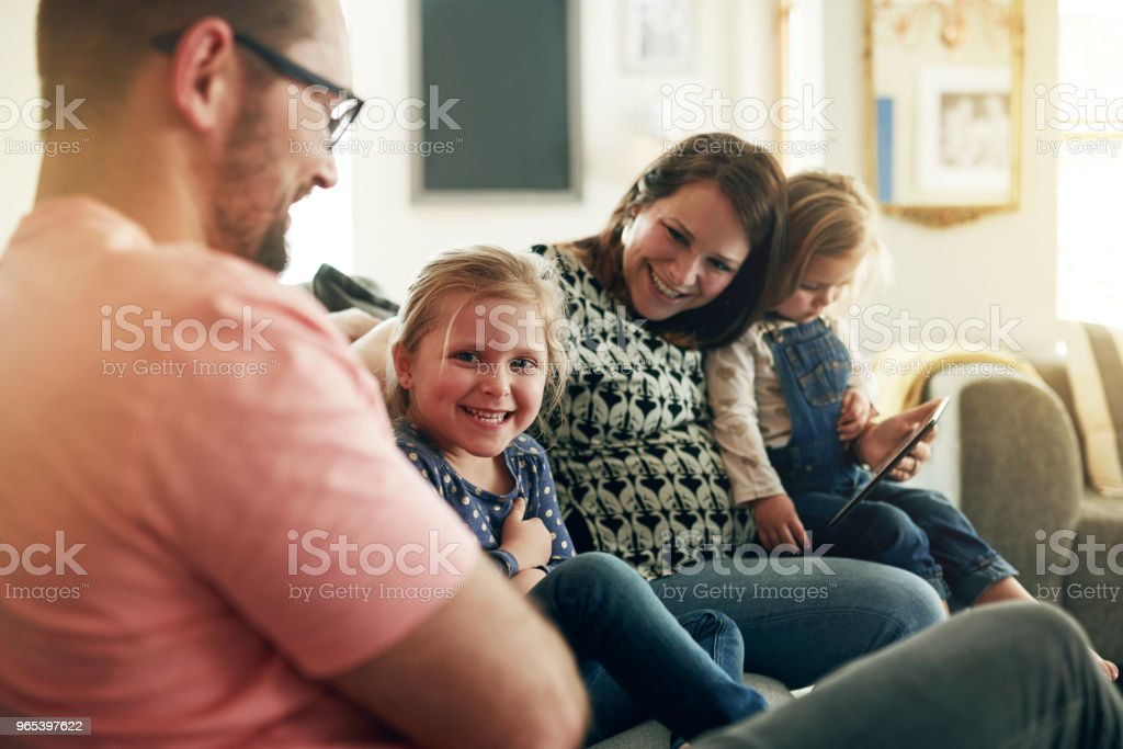 Using mobile apps that connect the whole family zbiór zdjęć royalty-free