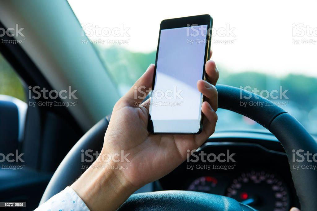 Using mobile phone in car stock photo