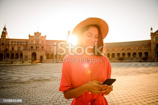 istock Using mobile phone. 1048635488