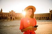 Elegant woman visiting Plaza de Espana, Sevilla