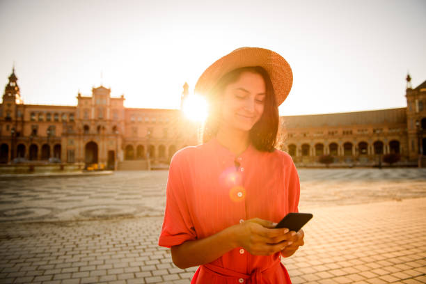 Using mobile phone. Elegant woman visiting Plaza de Espana, Sevilla cordoba spain stock pictures, royalty-free photos & images