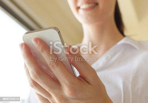 855341616istockphoto Using mobile smart phone 969253510