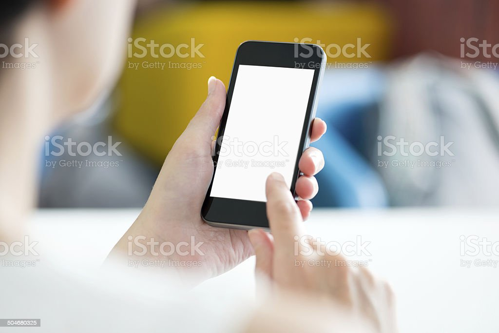 Using modern smartphone in office stock photo