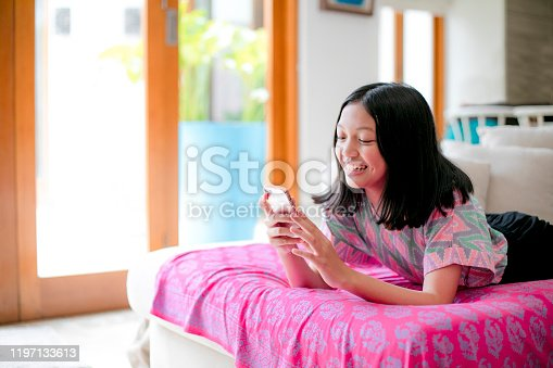 using phone  on couch