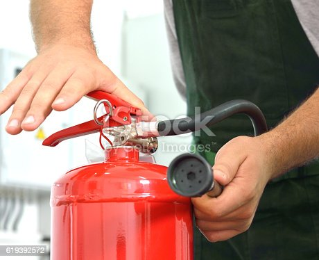 Worker Demonstrates the use of fire extinguishers.