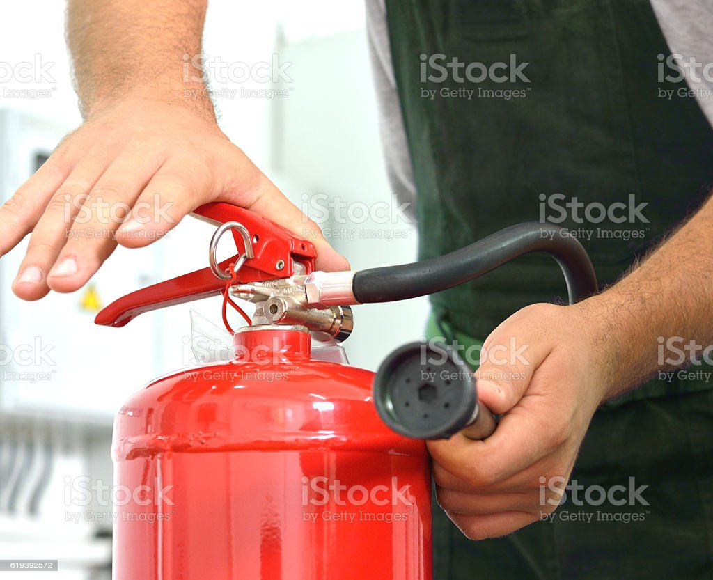 Using of Fire Extinguisher. stock photo