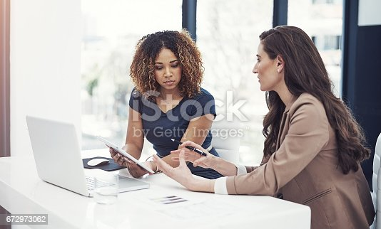istock Using online resources for a team task 672973062