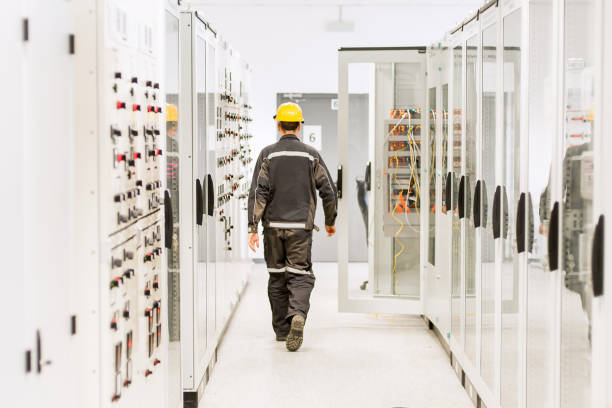 Using protective relay and medium voltage switchgear. Engineering department Using protective relay and medium voltage switchgear. Engineering department. Bay control unit coupling device stock pictures, royalty-free photos & images