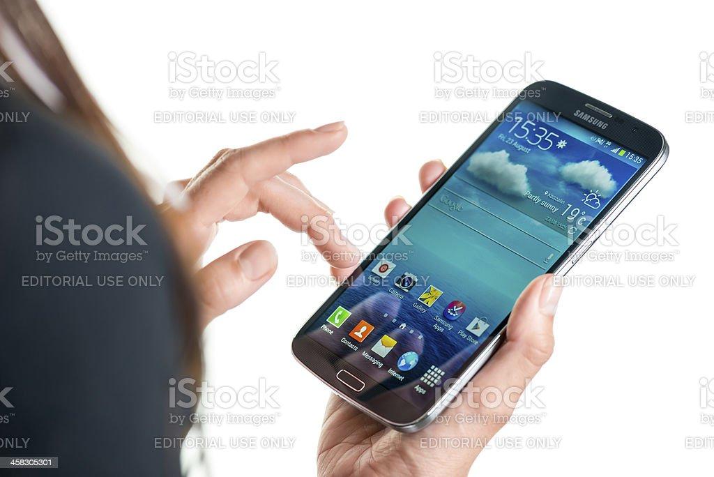 Using Samsung Galaxy Mega royalty-free stock photo