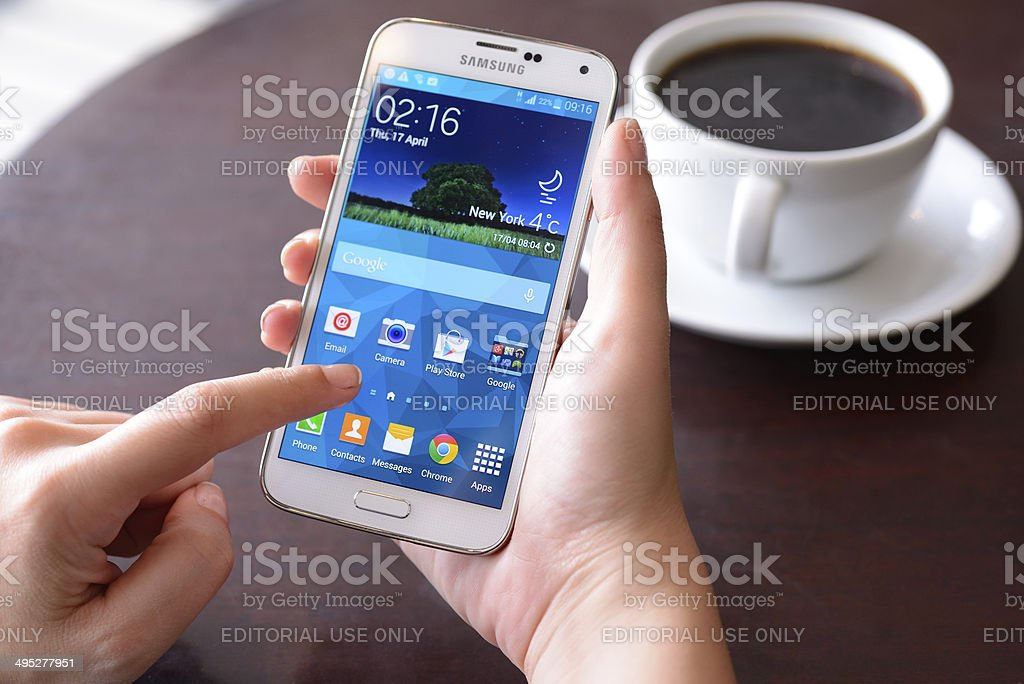 Using Samsung Galaxy touch screen smart phone stock photo