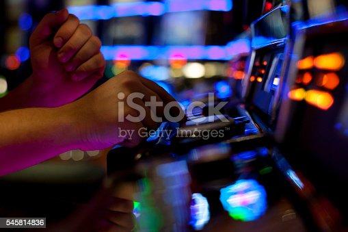 istock Using slot machine 545814836