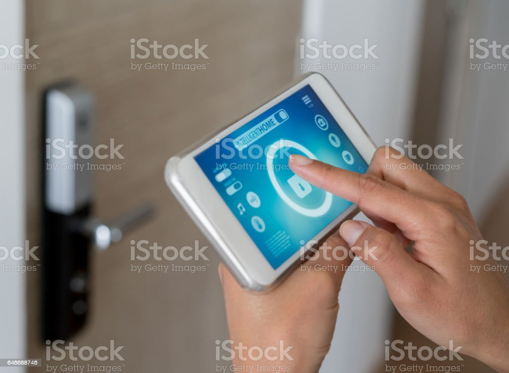 Using smart home security app stock photo