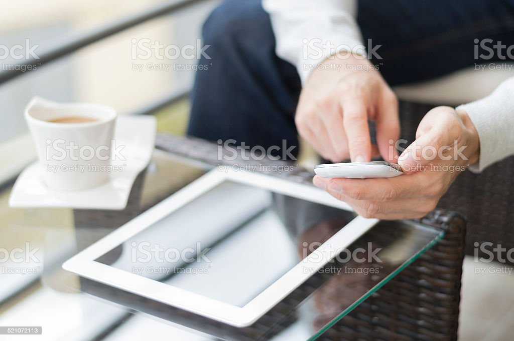 Using smart phone and digital tablet - Royalty-free Adult Stock Photo