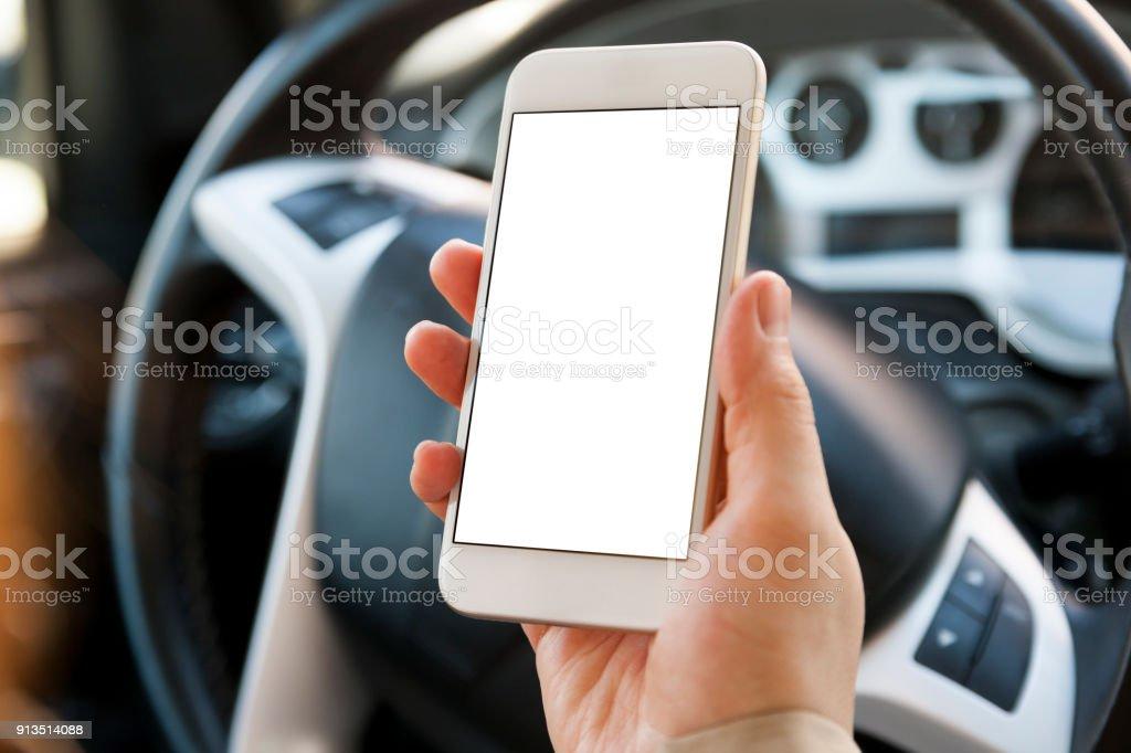 Mit Smartphone im Auto – Foto