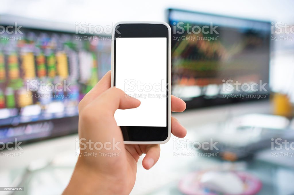 Using smart phone in Stock market graph and office work royalty-free stock photo