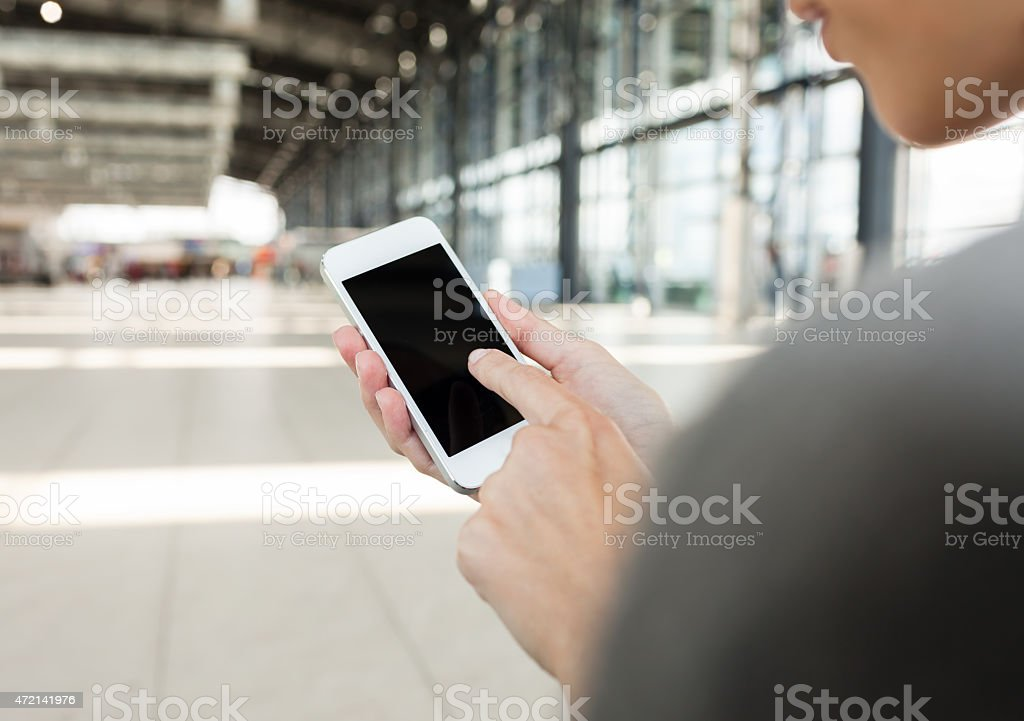 Using smart phone mobile at the airport. stock photo