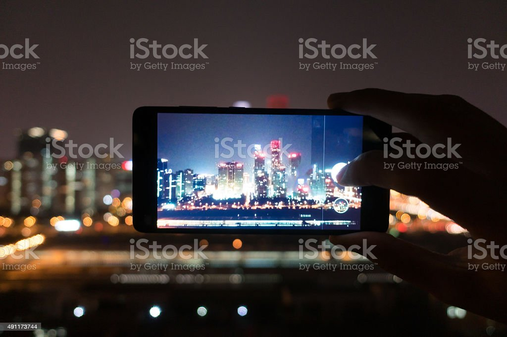 Using smart phone take photo stock photo