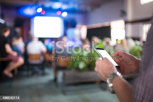 istock Using smart phone while on seminar 496040114