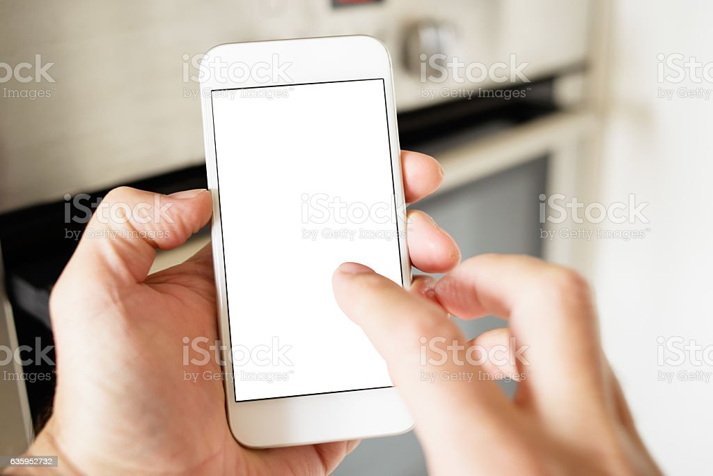 Using Smart Phone with Blank Screen POV in Domestic Kitchen stock photo