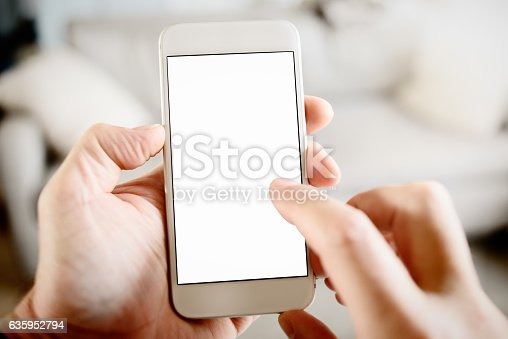 istock Using Smart Phone with Blank Screen POV in Domestic Lounge 635952794