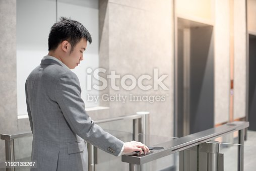 istock Using smart smartphone to open automatic gate 1192133267