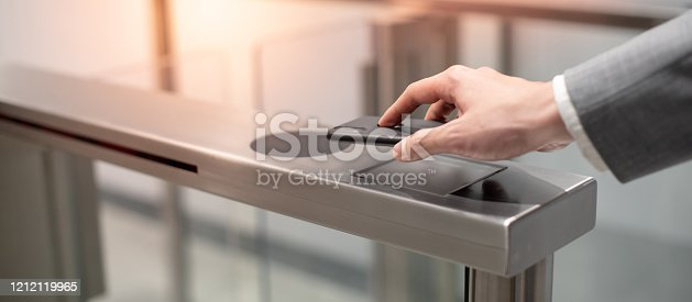 istock Using smart smartphone to open automatic gate 1212119965