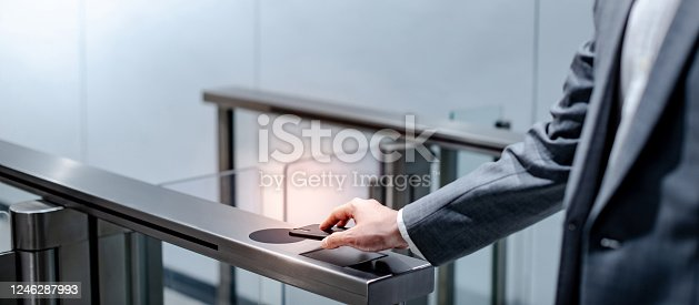istock Using smart smartphone to open automatic gate 1246287993
