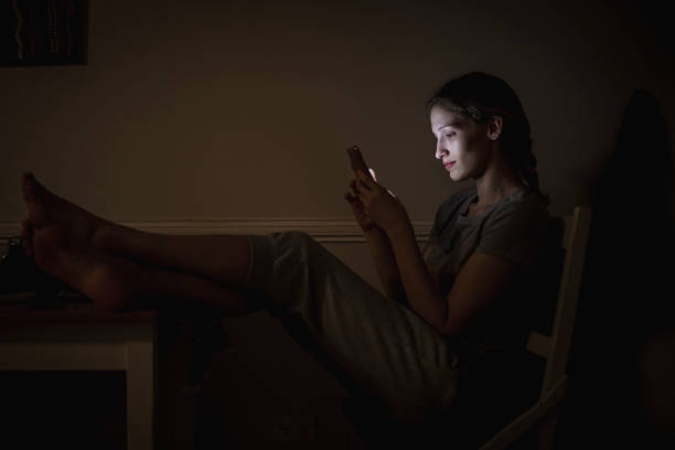using smartphone at night - smartphone addiction not groups stock pictures, royalty-free photos & images
