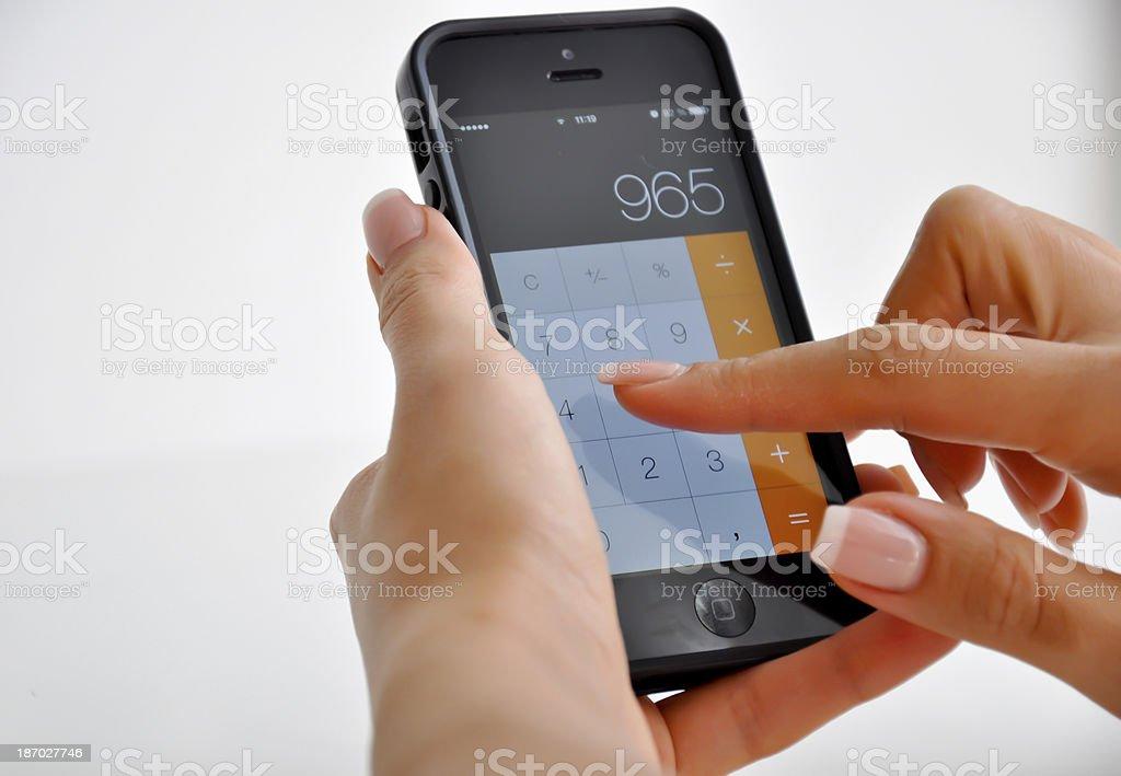 using smartphone calculator stock photo