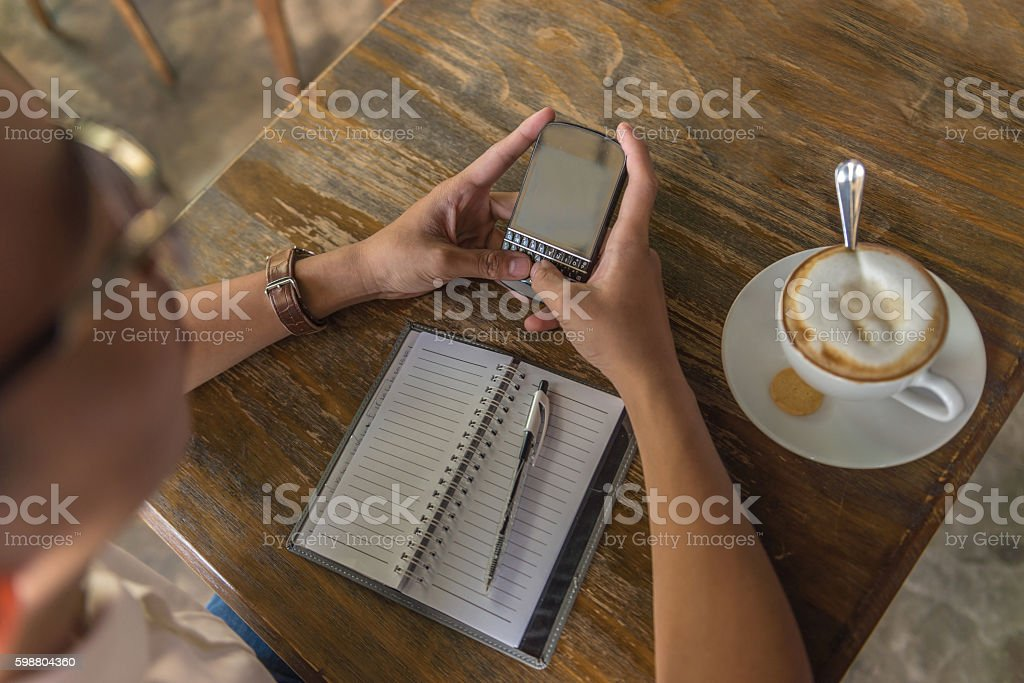 Using smartphone for searching information on Internet is popular stock photo