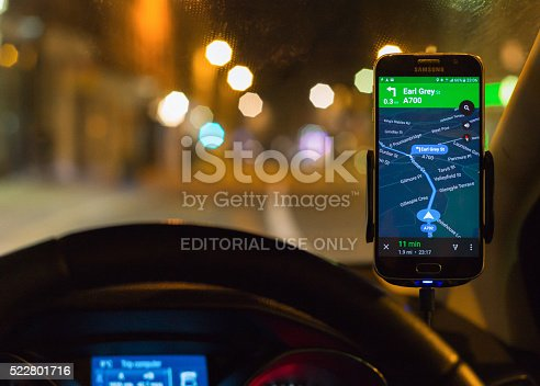 istock Using smartphone SatNav at night for driving directions. 522801716