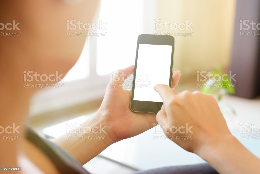 Using Smartphone with Blank Screen at Home stock photo