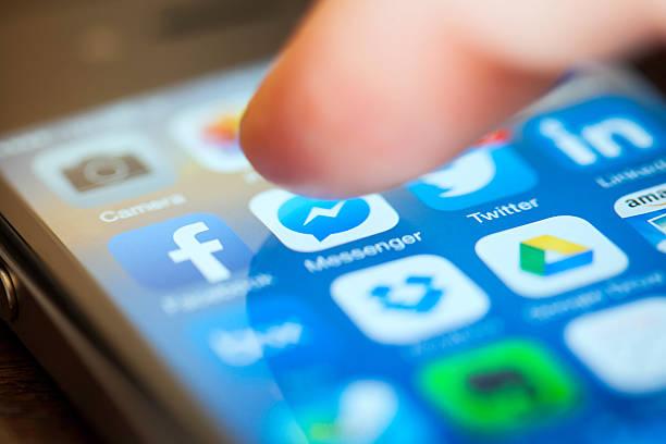 Using Social Media on iPhone stock photo