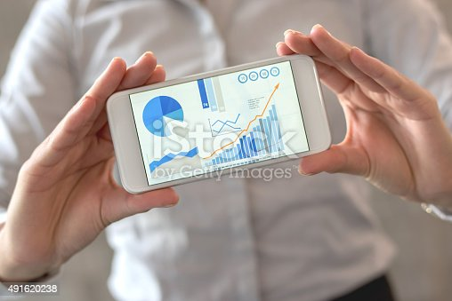 istock Using statistics business app on a cell phone 491620238