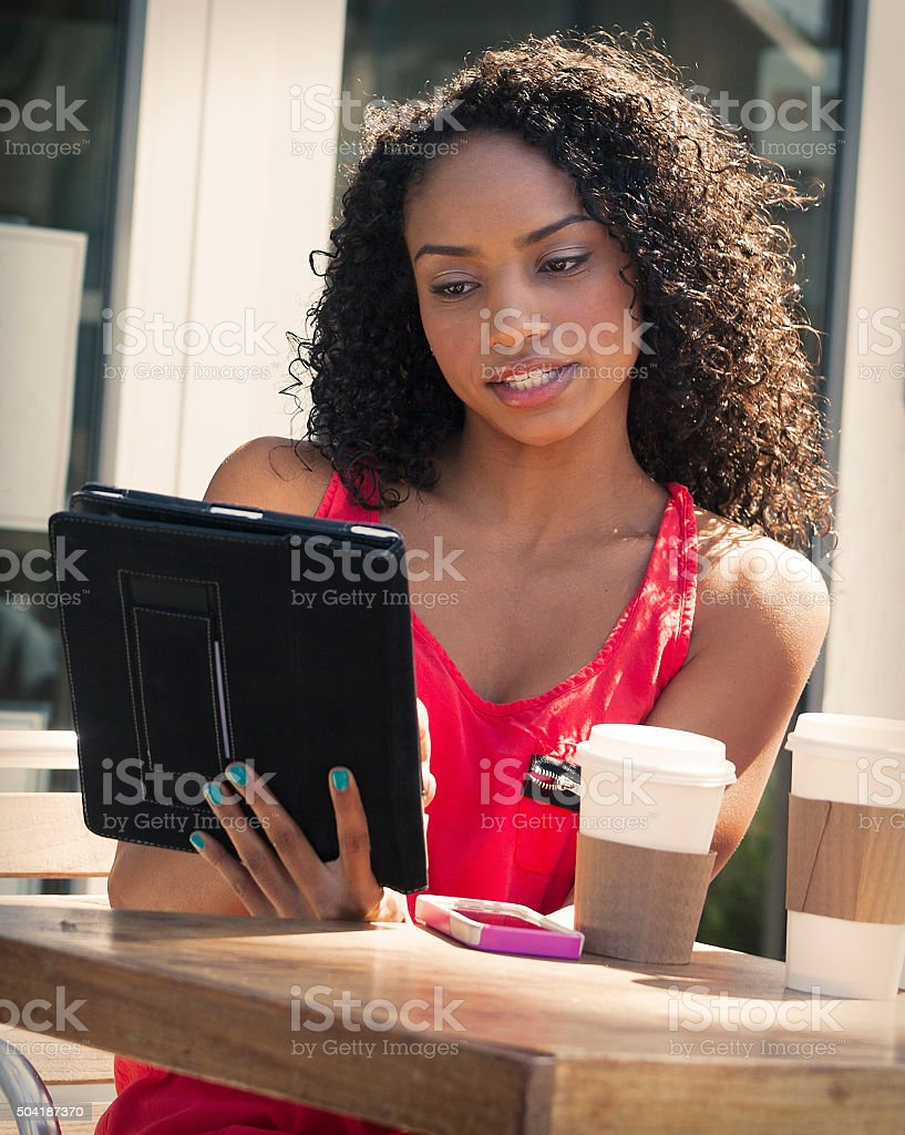 Using tablet at a Cafe stock photo