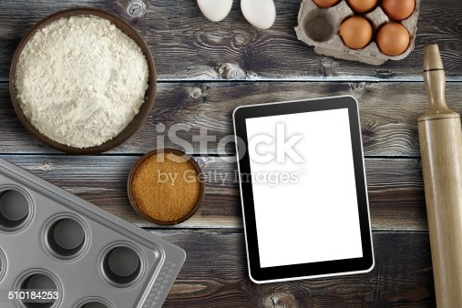 Directly above view of a wood table with pastry ingredients.