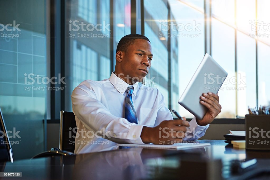 Using the internet to his advantage stock photo
