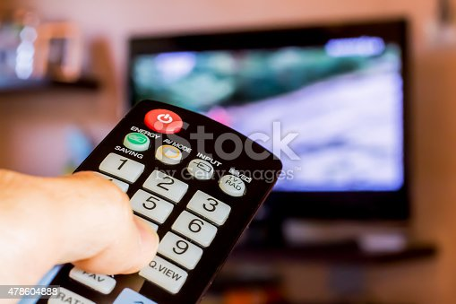 istock Using the remote control to change channesl on Tv 478604888